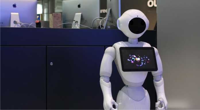 German Refugees learn German from a Robot